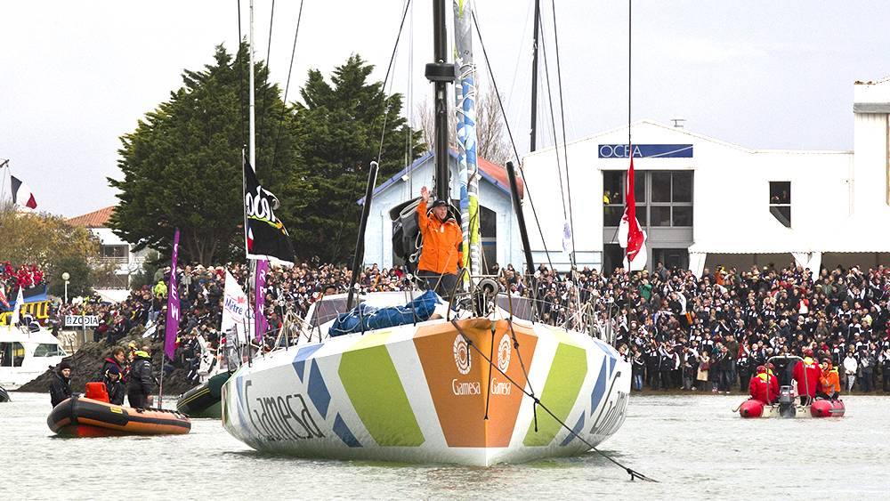 Vendee Globe - exiting the canal Les Sable d'Olonne, every inch of the shoreline was packed!
